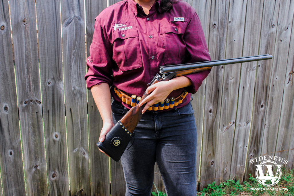 a photo of a female competition shooter with a side by side shotgun