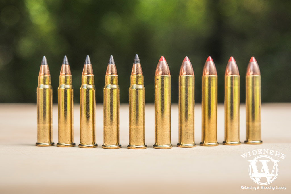 photo of 17 HMR bullets next to 22 magnum bullets outdoors