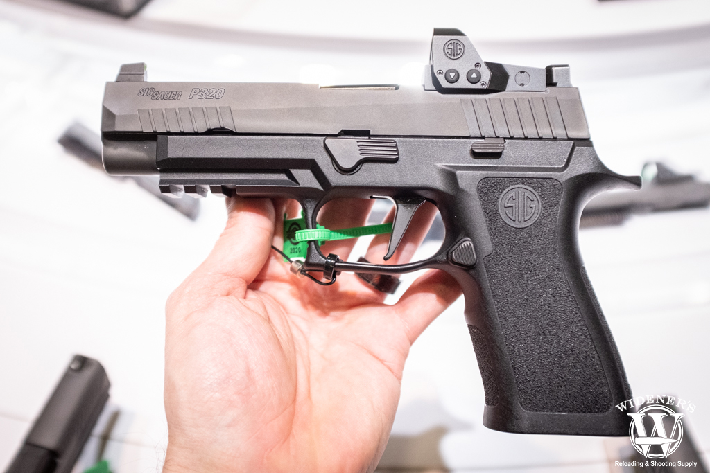 a photo of the Sig Sauer P320 RXP 9mm pistol with romeo1 pro optic