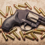 photo of smith and wesson 38 special revolver with ammo