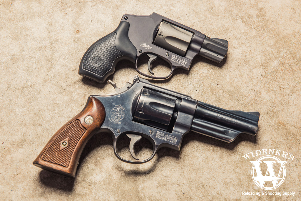 photo of a 38 special smith and wesson revolver compared to a 357 magnum smith and wesson revolver
