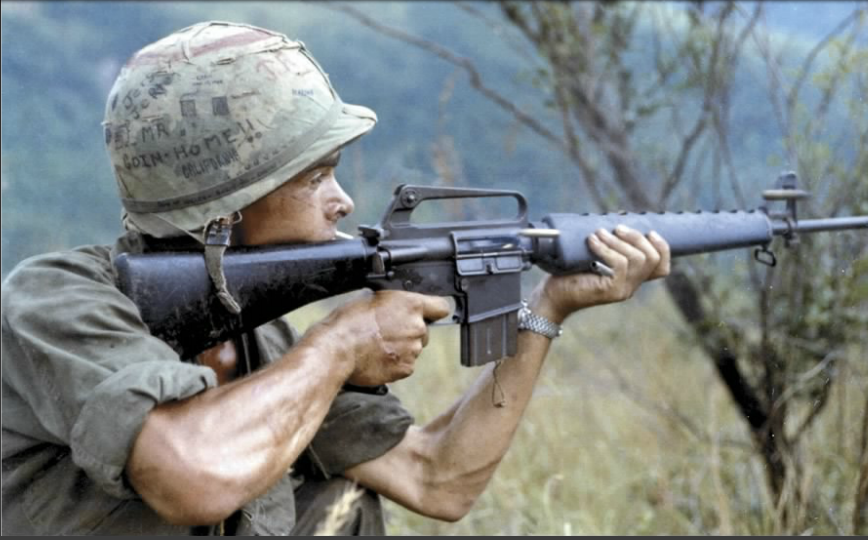 photo of vietnam war US soldier firing an m16 rifle