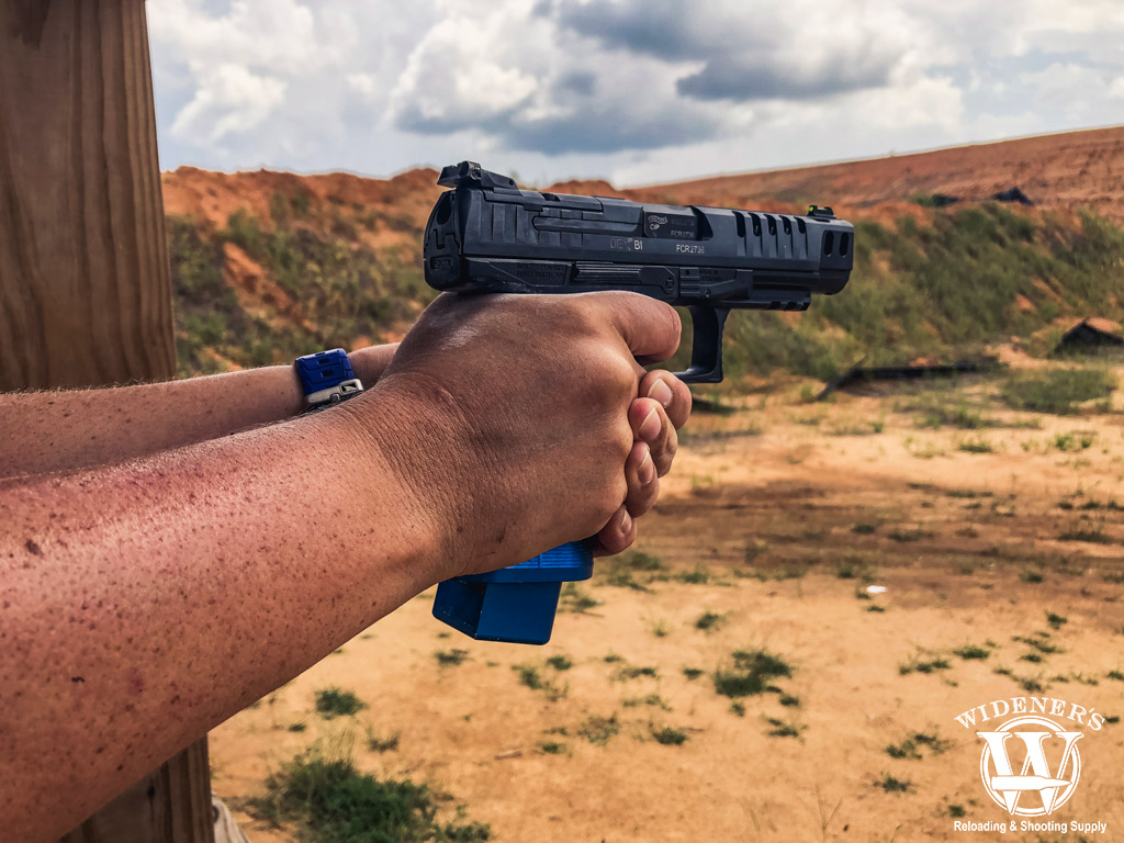 a photo of a competition pistol being shot at a gun range