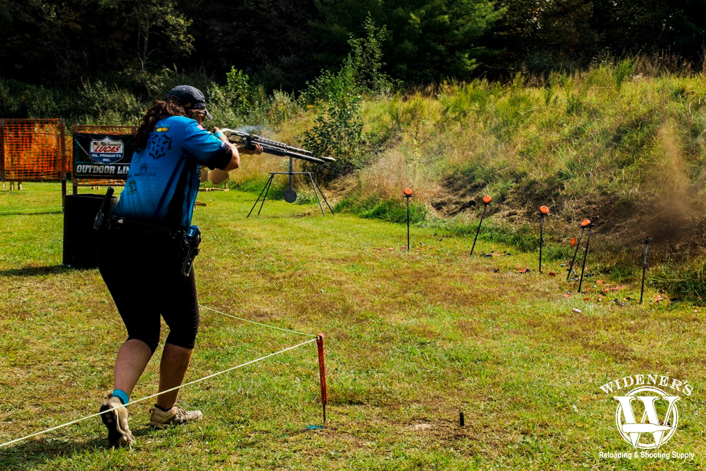 a photo of a female competition shooter