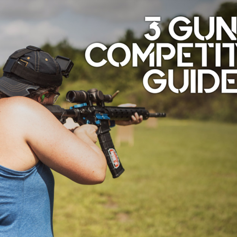 a photo of a female shooting guns at 3 gun competition