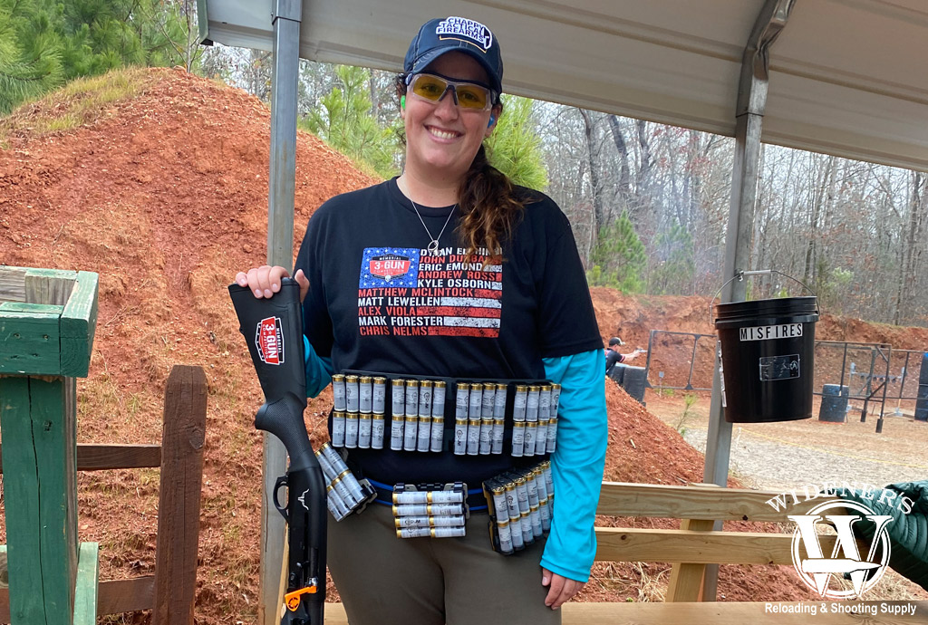 a photo of a female 3 gun competition shooter with 12 gauge shotgun