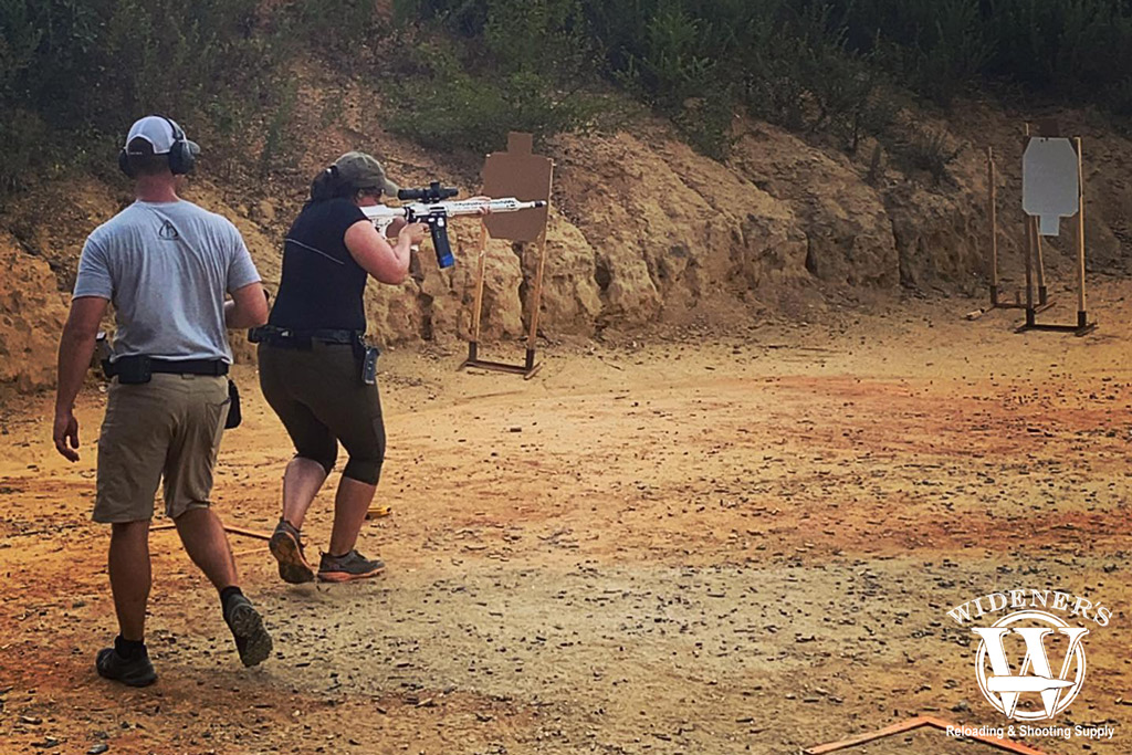 a photo of a female shooting a competition rifle