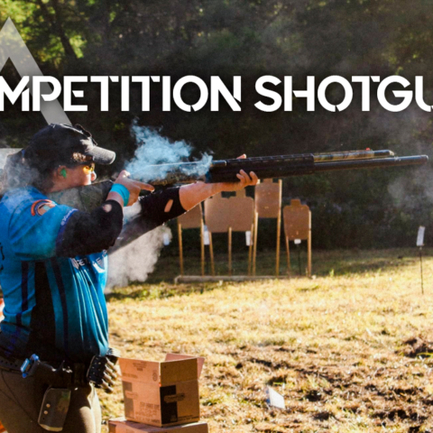 a photo of a woman shooting a competition shotgun