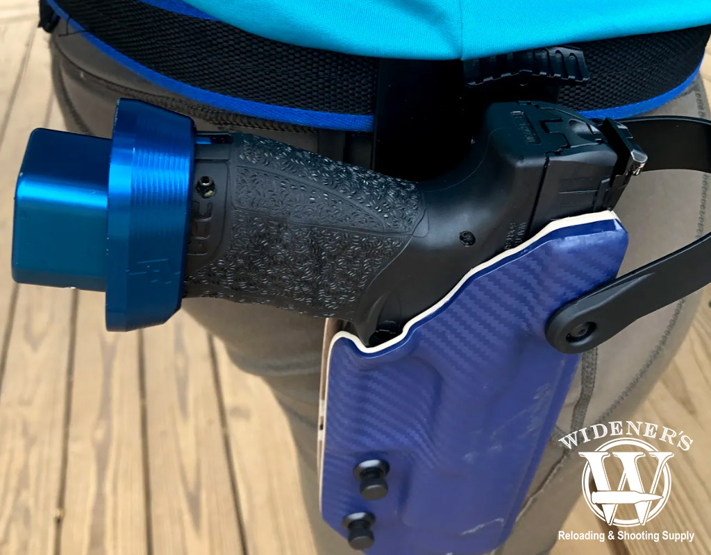 a photo of a walther ppq pistol in a holster with magazine extension