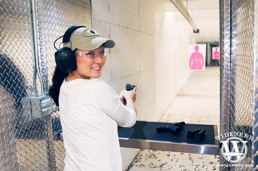 a photo of a female at a shooting range